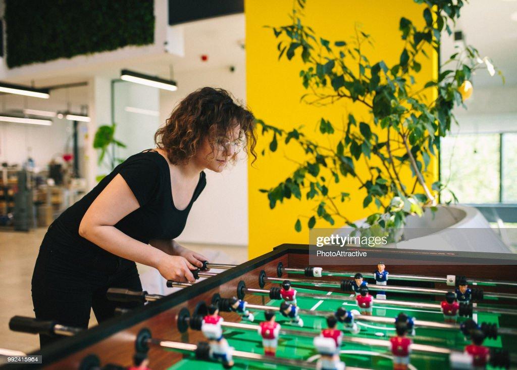 Happy young women playing table football   Stock Photo e2e1b2b50e
