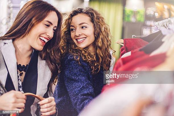 Happy young women shopping clothes