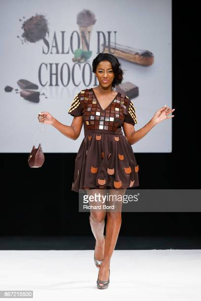 Hapsatou Sy walks the runway during the Dress Chocolate show as part of Salon du Chocolat at Parc des Expositions Porte de Versailles on October 27...
