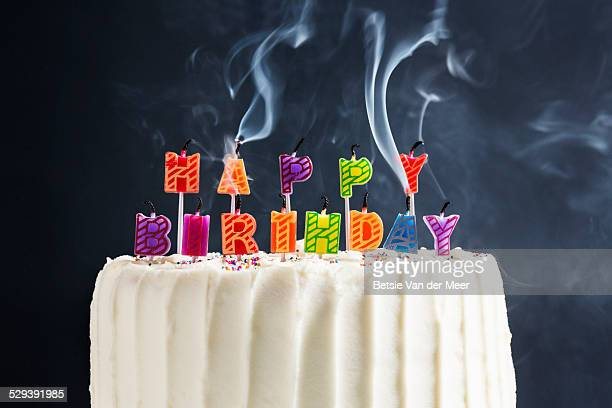 hapstill life of happy birthday candles blown out. - birthday cake stock photos and pictures
