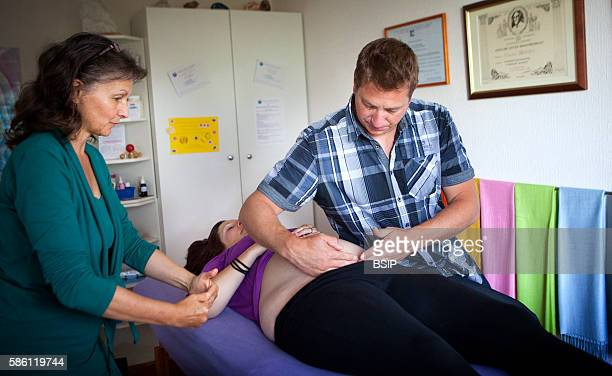 Haptonomy session with a couple in the 6th month of pregnancy The professional suggests massage techniques that help the relaxation and wellbeing of...