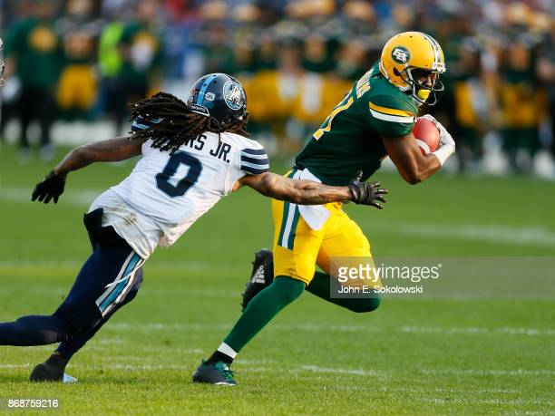 D'haquille Williams of the Edmonton Eskimos tries to outrun Johnny Sears Jr #0 of the Toronto Argonauts during a game at BMO field on September 16...