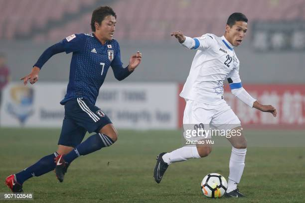 Hara Teruki of Japan and Abdixolikov Bobir of Uzbekistan in action during AFC U23 Championship Quarterfinal between Japan and Uzbekistan at Jiangyin...