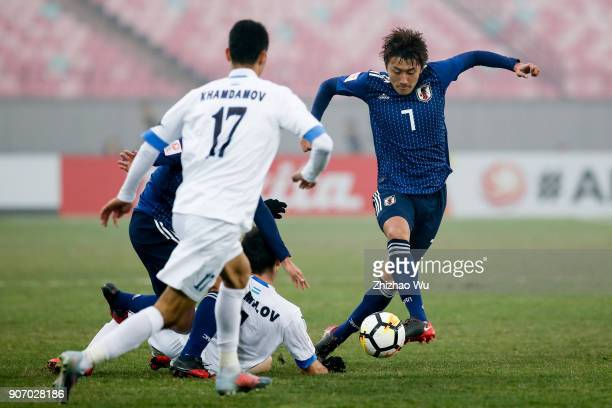 Hara Teruki of Japan controls the ball during AFC U23 Championship Quarterfinal between Japan and Uzbekistan at Jiangyin Sports Center on January 19...
