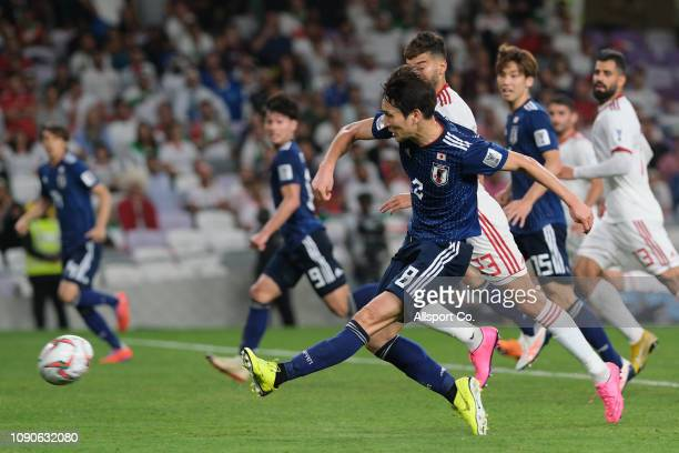 Haraguchi Genki of Japan shoots and scored against Iran during the AFC Asian Cup semi final match between Iran and Japan at Hazza Bin Zayed Stadium...