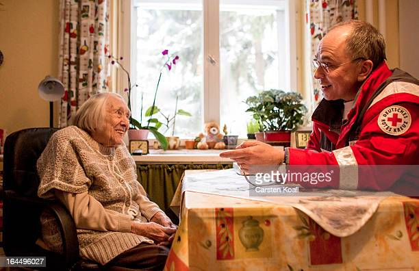 Harald Gross who works for the German Red Cross makes a visit to 100yearold senior citizen Frida Fiedler in order to illustrate the emergency...