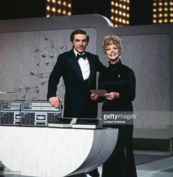 Harald Juhnke and Barbara Schöne are moderating the latenight show 'Musik ist Trumpf' Germany 1970s
