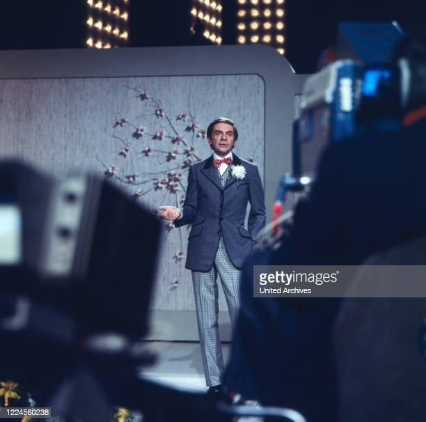 Harald Juhnke at the moderation of his Late Night Show 'Musik ist Trumpf' Germany 1970s