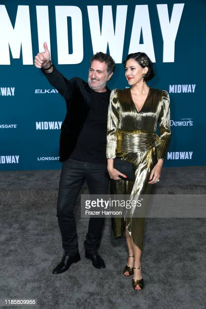 Harald Kloser and Annie Trousseau attend the Premiere Of Lionsgate's Midway at Regency Village Theatre on November 05 2019 in Westwood California