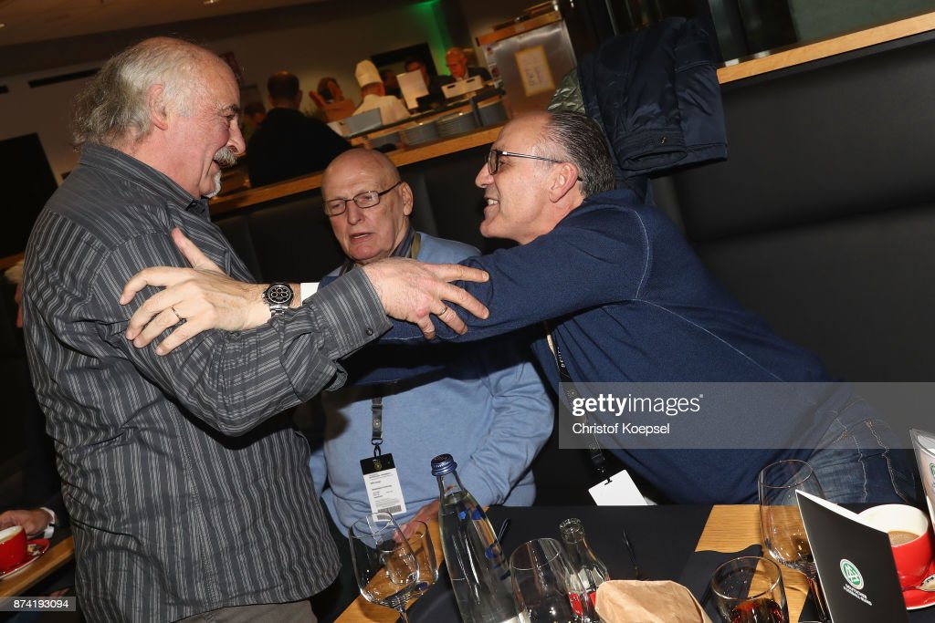 Harald Konopk, Manfred Manglitz and Juergen Kohler talk during the Club Of Former National Players Meeting at RheinEnergieStadion on November 14, 2017 in Cologne, Germany.