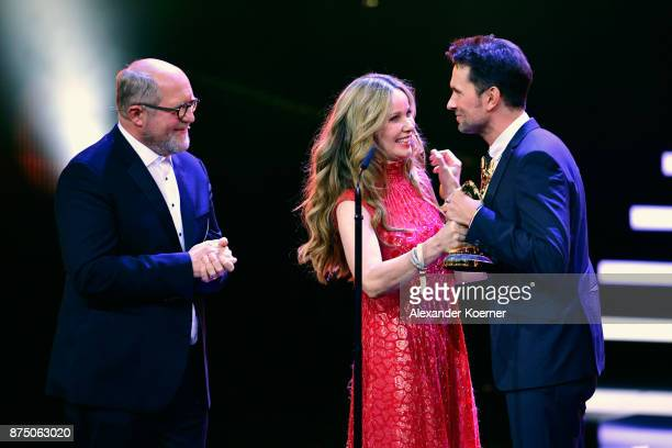Harald Krassnitzer and AnnKathrin KramerSimon are seen on stage with 'Film National' Award Winner Simon Verhoeven during the Bambi Awards 2017 show...