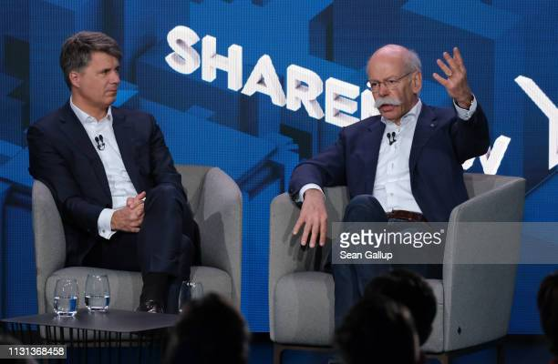 Harald Krüger CEO of BMW AG and Dieter Zetsche CEO of Daimler AG speak to the media about a new joint effort between the two automakers in carsharing...