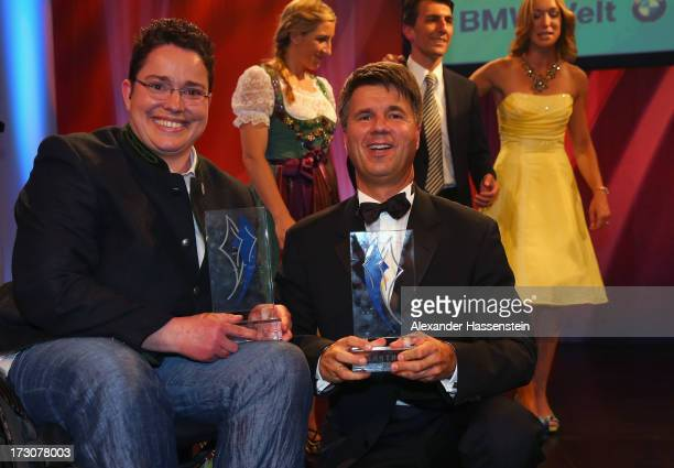 Harald Krueger Board of Management member for Production of BMW AG poses with Birgit Kober after receiving the Bavarian Sportaward 2013 at the...