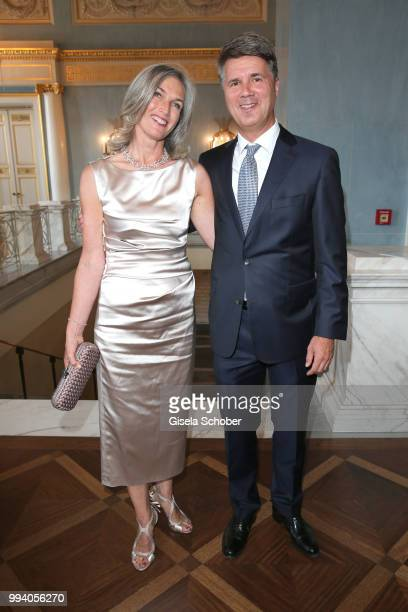 Harald Krueger CEO BMW and his wife Martina Krueger during the 'Oper fuer alle Parsifal' as part of the Munich Opera Festival at Nationaltheater on...