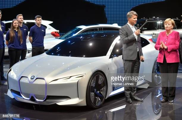 Harald Krueger CEO of German carmaker BMW shows the German Chancellor Angela Merkel an 'i Vision Dynamic' allelectric concept car on September 14...