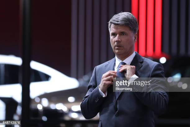 Harald Krueger chief executive officer of Bayerische Motoren Werke AG adjusts his tie ahead of the 87th Geneva International Motor Show in Geneva...