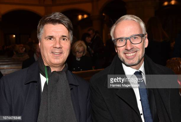 Harald Kruger CEO and Chairman of the Board of Management of BMW AG and Bernd Doepke Manage Retail Outlet Munich Sales Germany attend the 23rd BMW...