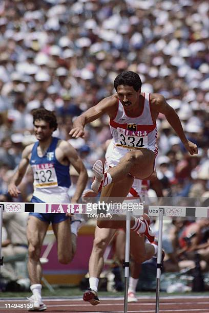 Harald Schmid of West Germany clears the hurdles on his way to a bronze medal in the Men's 400 metre Hurdles during the XXIII Summer Olympics on 5th...