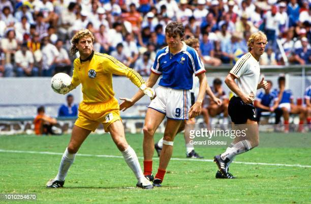 Harald Schumacher of West Germany and Luis Fernandez of France during the World Cup semi final match between West Germany FRG and France played in...