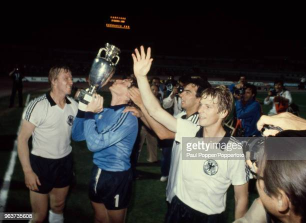 Harald Schumacher of West Germany lifts the trophy after the UEFA Euro 1980 Final between Belgium and West Germany at the Stadio Olympico on June 22,...