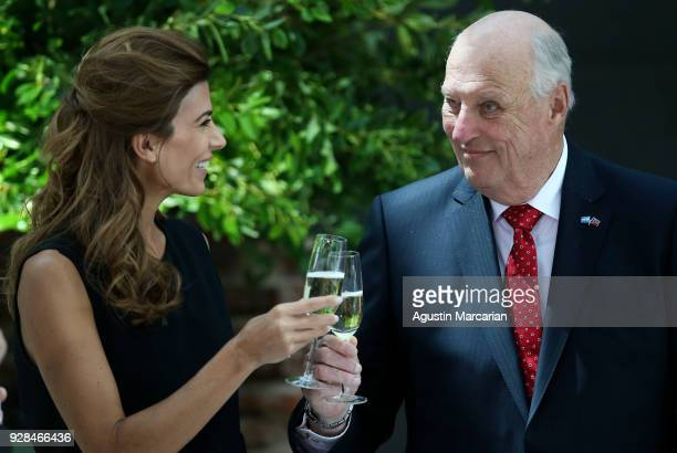 Harald V of Norway and the First Lady of Argentina Juliana Awada toast at Casa Rosada during the official visit of the Kings of Norway to Buenos...