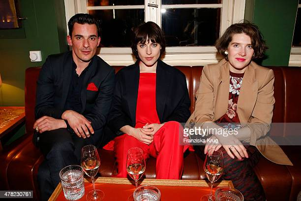 Harald Wegener, Antje Traue and Leena Zimmermann attend the Drykorn X Bungalow Dinner at Pauly Saal on March 12, 2014 in Berlin, Germany.