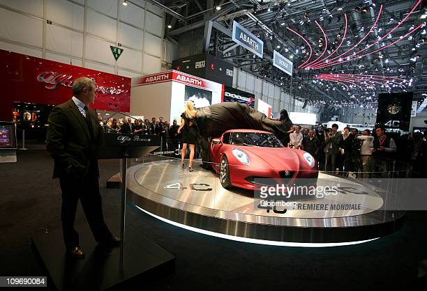 Harald Wester chief executive officer of Fiat SpA's Alfa Romeo brand left watches the launch of the Alfa Romeo 4C concept automobile at the Geneva...