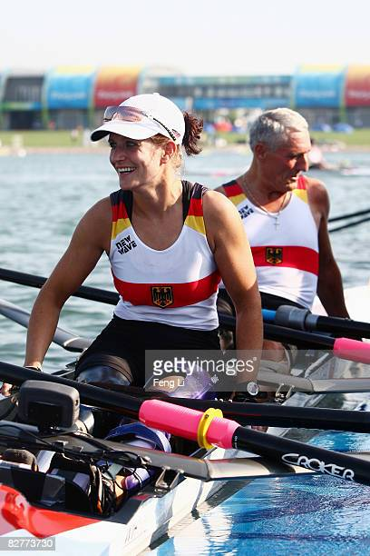 Harald Wimmer and Siglind Koehler of Germany celebrate after claiming third place of the Rowing Mixed Double Sculls TA Fina B at Shunyi Olympic...