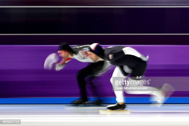 Haralds Silovs of Latvia and Mitchell Whitmore of the United States compete during the Speed Skating Men's 1000m on day 14 of the PyeongChang 2018...