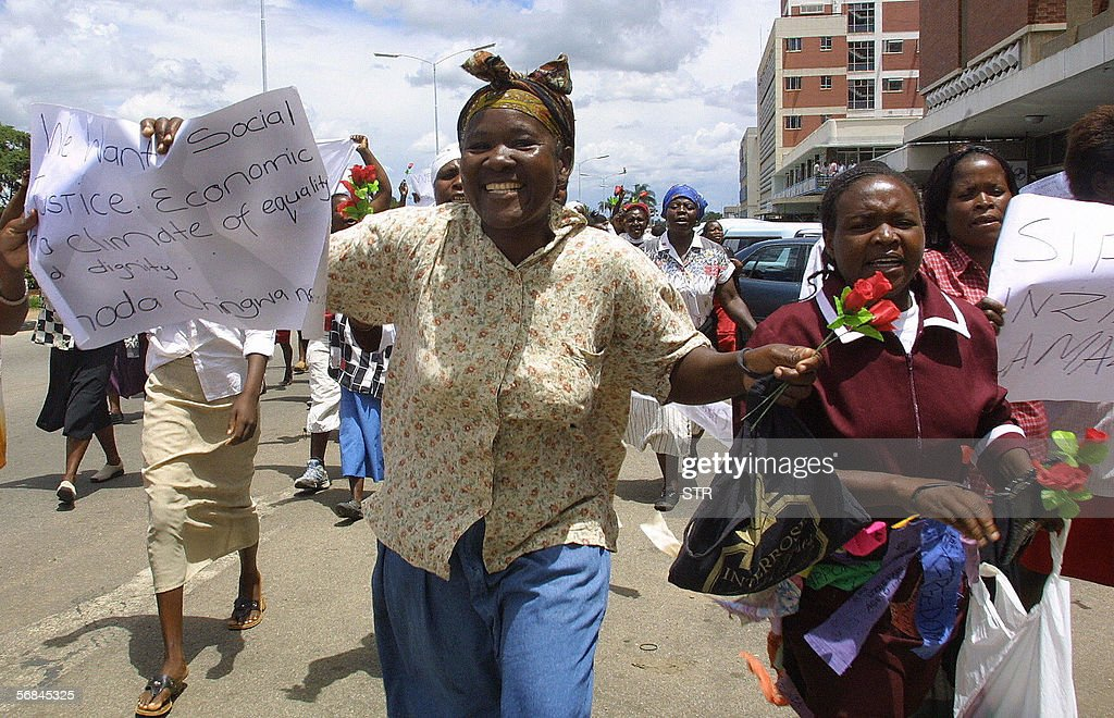 Protesters march through the streets of Harare, 14 February 2006 in a demonstration organised by the pressure group, Women of Zimbabwe Arise (WOZA) to protest the rising cost of living in the country and the call for social justice.The march which coincided with St Valentine's Day was modelled along the 1912 Bread and Rose strike in the United States of America.