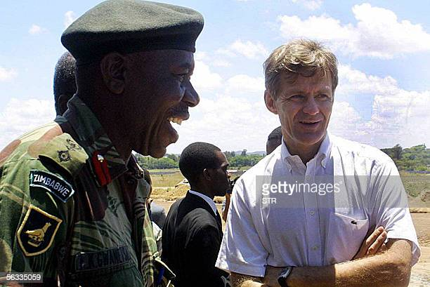 UN aid coordinator Jan Egeland talks next to a Zimbabwean army officer as he visits the victims of the Operation Clean Up in Harare 05 December 2005...