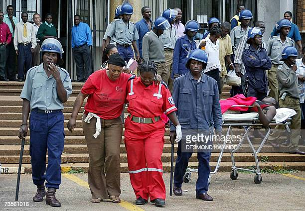 Zimbabwean opposition members leave 13 March 2007 the Harare magistrate's court and are taken to a hospital to recieve treatment for injuries...