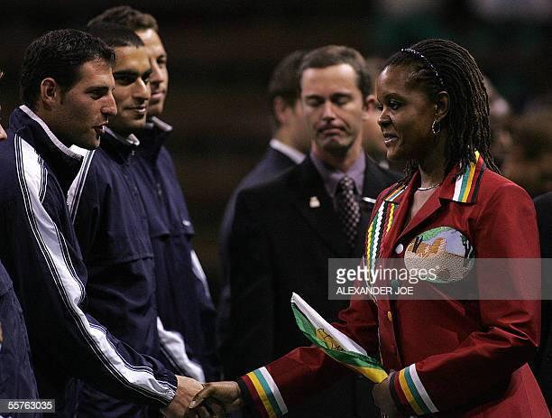 Zimbabwe's Frist Lady Grace Mugabe shakes hands with members of the Israel's Davis cup Team in Harare 24 September 2005 before their Davis cup double...