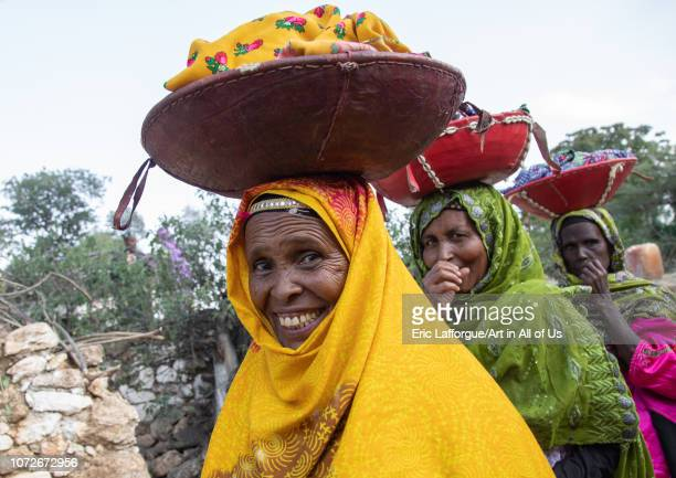 Harari women bringing injeras in baskets on their heads for a muslim celebration Harari Region Harar Ethiopia on November 4 2018 in Harar Ethiopia