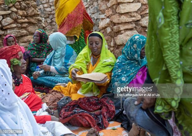 Harari women preparing injera for a muslim celebration Harari Region Harar Ethiopia on November 4 2018 in Harar Ethiopia