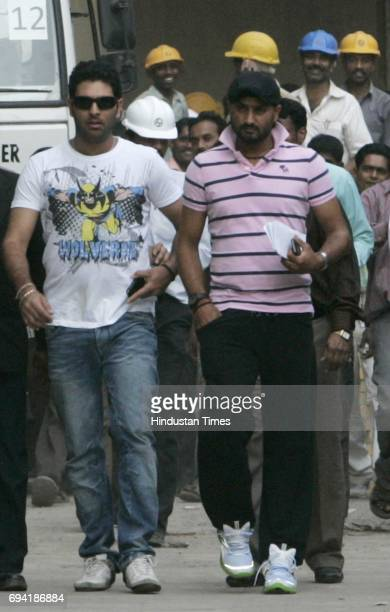 Harbhajan Singh and Yuvraj Singh walk out of Wankhede stadium after taking a look at the renovated stadium on Friday The duo had earlier visited BCCI...