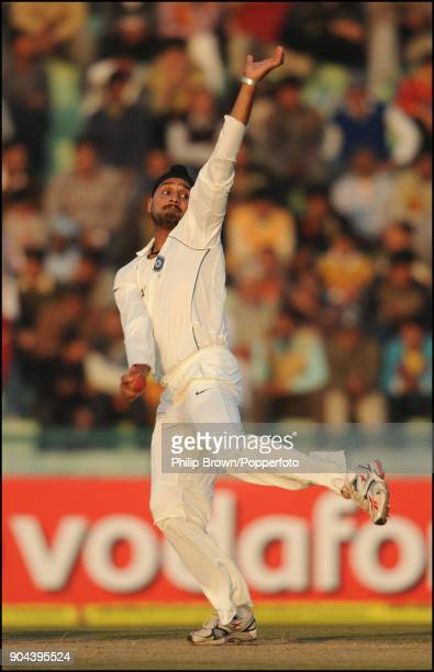 Harbhajan Singh bowling for India during the 2nd Test match between India and England at the Punjab Cricket Association Stadium Mohali India 21st...
