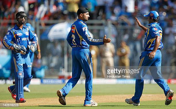 Harbhajan Singh celebrates after capturing the wicket of captain Sourav Ganguly of the Pune Warriors during the IPL 5 match between the Mumbai...