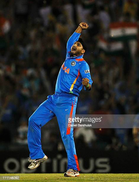 Harbhajan Singh of India celebrates after taking the wicket of Shahid Afridi of Pakistan during the 2011 ICC World Cup second SemiFinal between India...