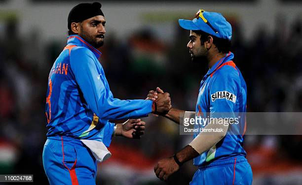 Harbhajan Singh of India celebrates with team mate Virat Kohli after taking the wicket of AB de Villiers of South Africa during the Group B ICC World...