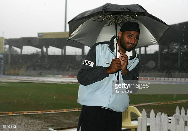 Harbhajan Singh of India stands in a rain soaked field as rain prevents play during day five of the Second Test between India and Australia played on...