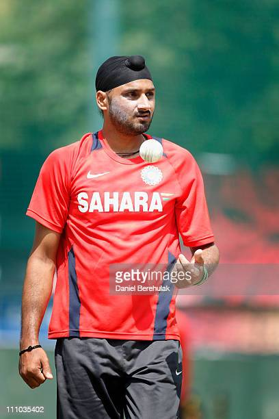 Harbhajan Singh of India walks back to bowl during an Indian team training session on March 29 2011 in Mohali India India will play Pakistan in the...