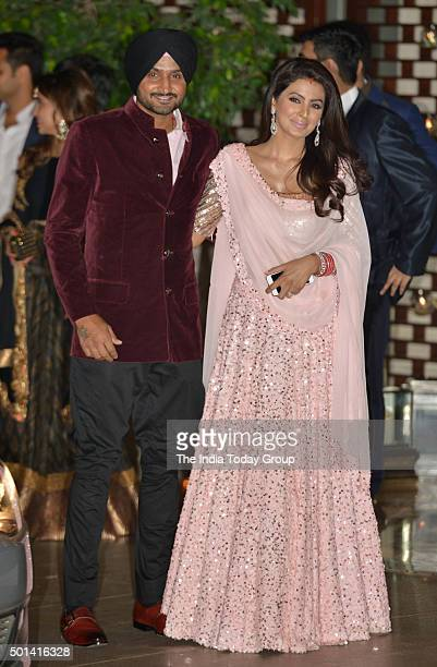 Harbhajan Singh with his wife Geeta Basra at Ambani's party to celebrate his wedding in Mumbai