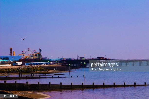 harbor against clear blue sky during sunset - southend on sea stock pictures, royalty-free photos & images