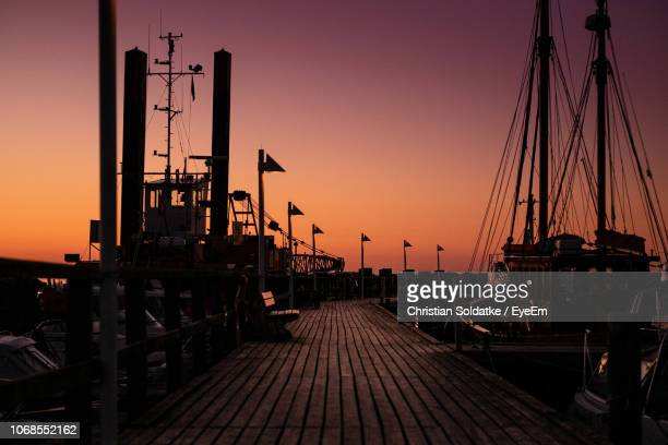 harbor against clear sky during sunset - christian soldatke stock pictures, royalty-free photos & images