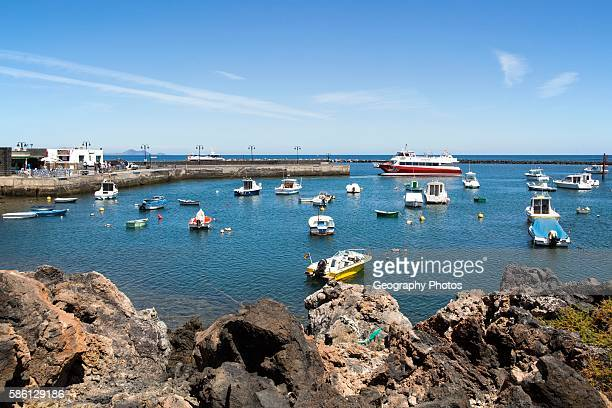 Harbor and ferry boat in the fishing village of Orzola Lanzarote Canary Islands Spain