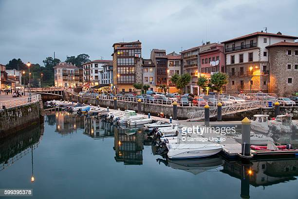 harbor and village of llanes illuminated at night - llanes fotografías e imágenes de stock