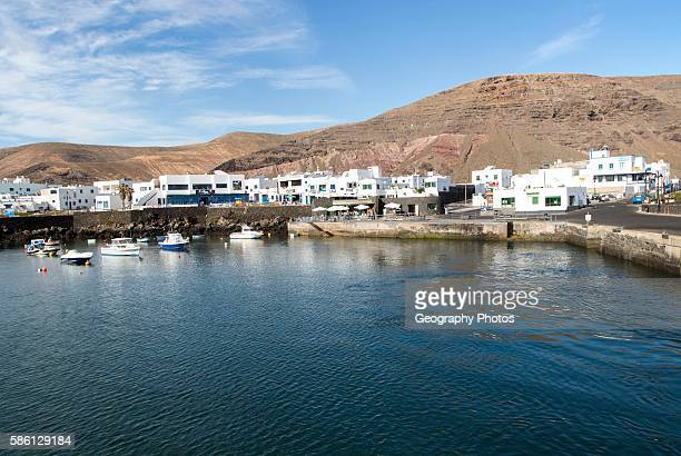 Harbor and white houses in the fishing village of Orzola Lanzarote Canary Islands Spain