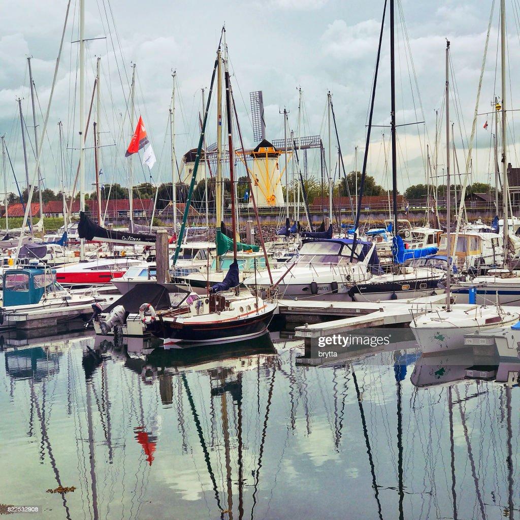 Harbor and windmill in Wemeldinge,Zeeland, the Netherlands : Stock Photo