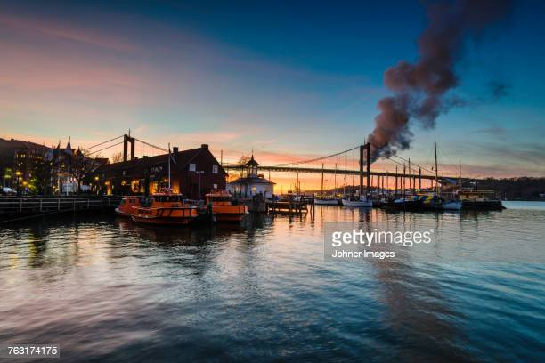 Harbor at sunset with Alvsborg Bridge on background, Gothenburg, Sweden
